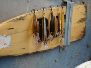 Bass Lures Hanging on paddle in boat