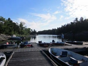 Bear's Den Lodge dock with rental boats parked for guests
