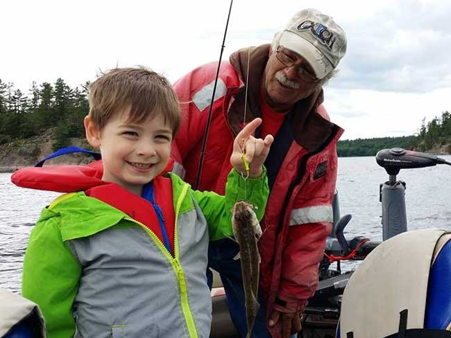 French River guide educating a child for this experience fishing.
