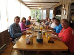 Family enjoying their breakfast of pancakes at Bear's Den Lodge