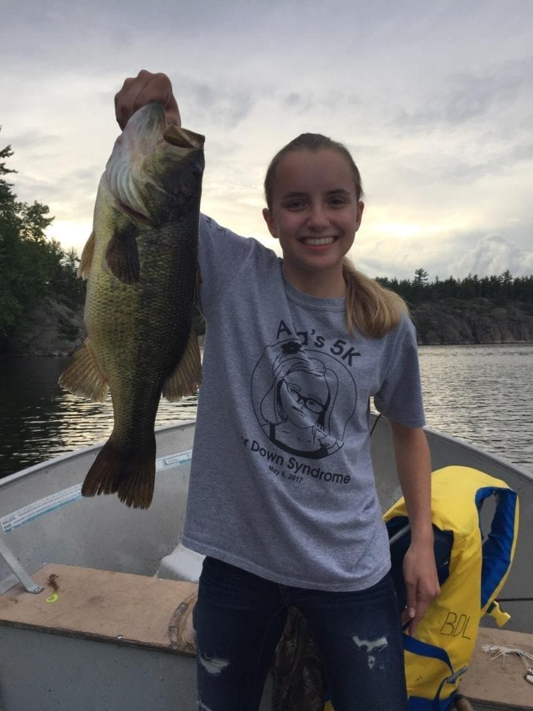 19-inch Largemouth Bass held by a French River female angler