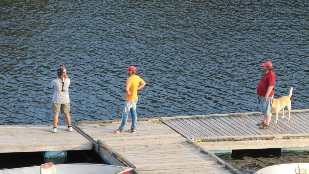 Fishing guide on French River teaching casting.